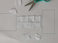 Photo showing cutting out square units with scissors activity